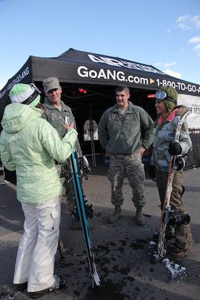 Utah Air National Guard recruiters Senior Master Sgt. Wayne Ormond (left) and Tech. Sgt. Spencer McWhorter work to find new recruits and create awareness of the ANG at the Sprint U.S. Snowboarding and Freeskiing Grand Prix at the Canyons Resort in Park City on Feb. 10, 2012. U.S. Air Force courtesy photo by Jake Ingle. (Released)