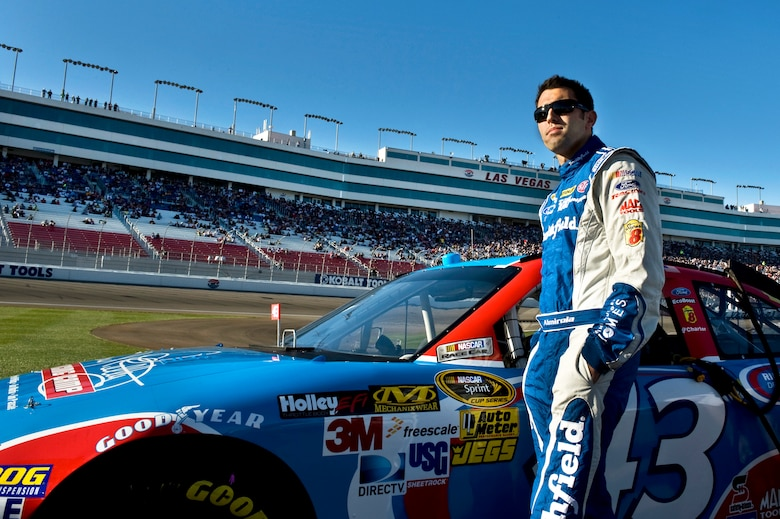 Aric Almirola, driver for the Air Force-sponsored No. 43 car, stands near his ride prior to the qualifying round for the Sprint Cup Series Race March 9, 2012 at the Las Vegas Motor Speedway. Almirola said he draws inspiration from Airmen as role models. (U.S. Air Force photo by Airman 1st Class Daniel Hughes)