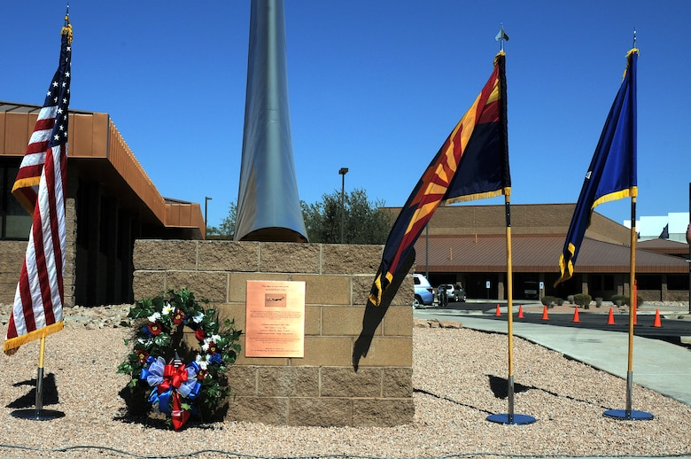A wreath adorns a new memorial featuring a KC-135 Stratotanker tail and plaque dedicated during a memorial ceremony March 13, 2012, at the 161st Air Refueling Wing, Phoenix. The memorial ceremony marked the 30th anniversary when four 161st Air Refueling Group servicemembers lost their lives while on-duty. (Photo by Staff Sgt. Michael Matkin/Released)