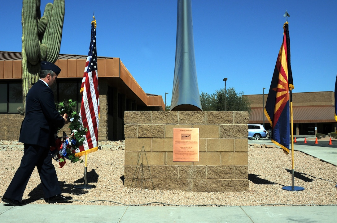 Col. Steven M. Balser, 161st Air Refueling Wing commander, lays a wreath on new memorial featuring a KC-135 Stratotanker tail and plaque, dedicated during a memorial ceremony March 13, 2012, at the 161st Air Refueling Wing, Phoenix. The memorial ceremony marked the 30th anniversary when four 161st Air Refueling Group servicemembers lost their lives while on-duty. (Photo by Staff Sgt. Michael Matkin/Released)