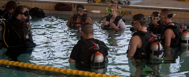Dave Stone, head instructor for the discover scuba course prepares Team Moody Airmen to use their scuba gear underwater at Moody Air Force Base, Ga., March 10, 2012. The scuba class was part of the Single Airmen Initiative, which gave Airmen the chance to try scuba for free to see if they have an interest in it. (U.S. Air Force photo by Airman 1st Class Nicholas Benroth/Released)