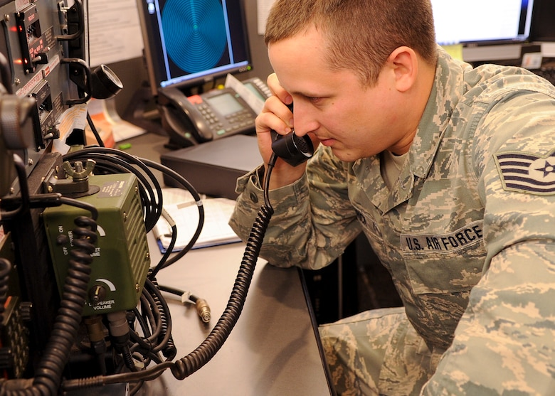 Tech. Sgt. Bruce Hedrick, a command post report NCOIC with the 180th Fighter Wing, Ohio Air National Guard, Swanton, Ohio tests a UHF/VHF/SATCOM radio. This radio allows command post personnel to speak to airborne pilots in both secure and non-secure capacities. The SATCOM capability of the radio allows world-wide communication with airborne pilots.