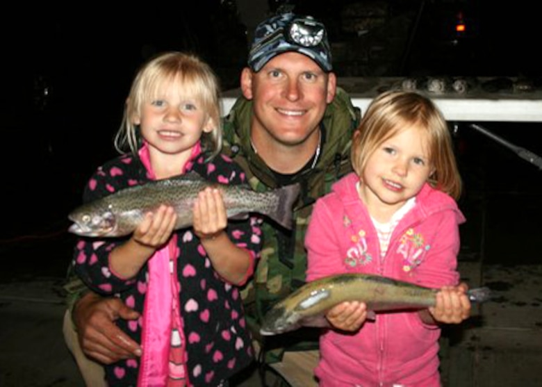 Master Sgt. Chad Hepner, 9th Medical Group first sergeant, displays the days catch with his daughters after a family fishing trip. Although Hepner is a devoted hunter, he said he enjoys fishing during off seasons. (U.S. Air Force courtesy photo)