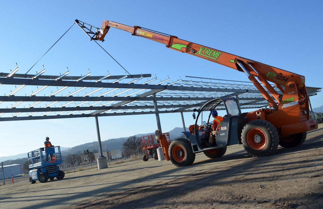 Construction workers build the frame for a one-megawatt solar microgrid project at Fort Hunter Liggett, Calif., Dec. 22, 2011. The frame will support photovoltaic panels, said Bob Roy, a project manager with the U.S. Army Corps of Engineers Sacramento District, which is overseeing the project. The grid, scheduled for completion in April 2012, is expected to be the first of four at the post. Once complete, the grid will generate enough energy to power 250 to 300 homes. Along with the energy production, the panel arrays will form a canopy that will shade the majority of the post's vehicles. (U.S. Army photo by Carlos J. Lazo/Released)