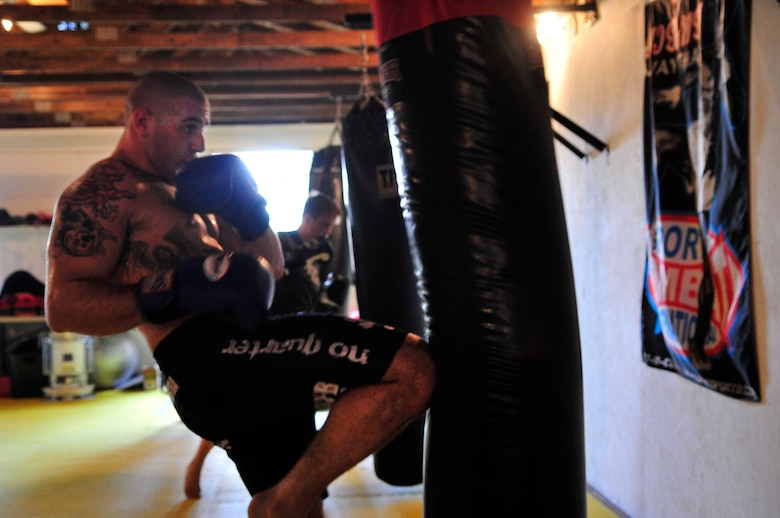COLUMBIA - U.S. Air Force Staff Sgt. Ferdinando Acerra, a maintenance training instructor assigned to the 20th Medical Operations Squadron, 20th Fighter Wing, Shaw Air Force Base, S.C. practices knee kicks while training at the Sor Sumrit Muay Thai Gym in Columbia, S.C. on March 13, 2012. Acerra, along with two others from his gym will compete in matches at Shaw AFB's first ever MMA event on March 30, 2012. (U.S.  Air Force photo/Master Sgt. Cohen A. Young/Released)