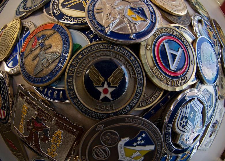 HOLLOMAN AIR FORCE BASE, N.M. -- Challenge coins have various purposes throughout the Air Force and various meanings to its Airmen. Some view it as a memento of significant value and others see it as just a collectible and everything in between.