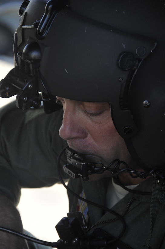 California Air National Guard Senior Master Sgt. Steve Burt, a flight engineer with the 129th Rescue Squadron, conducts a pre-flight check on an HH-60G Pave Hawk at Moffett Federal Airfield, Calif., March 9, 2012. Burt is preparing the helicopter for a resupply mission to support the PRBO Conservation Science group and the U.S. Fish and Wildlife Service at the Farallon National Wildlife Refuge off the coast of California. (Air National Guard photo by Staff Sgt. Kim Ramirez)