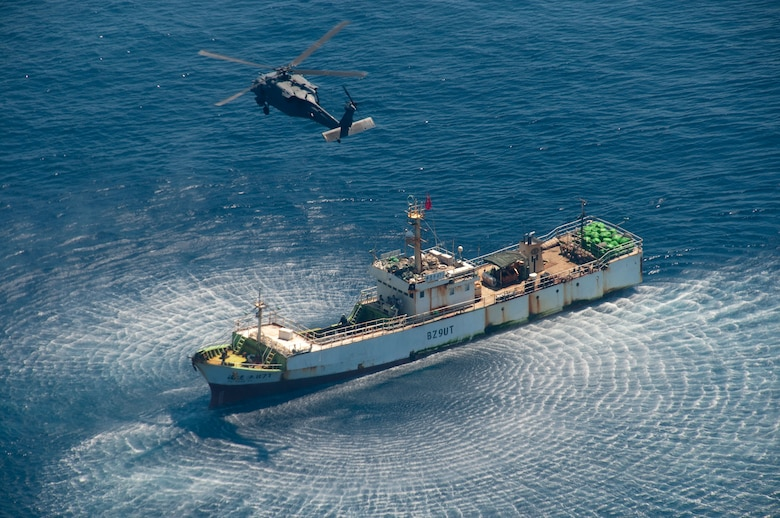 An HH-60G Pave Hawk rescue helicopter from the 129th Rescue Wing hovers over the Chinese fishing vessel Fu Yuan Yu #871, March 12, 2012. Guardian Angel Pararescuemen from the wing rescued two fishermen who were burned in a diesel fire onboard the vessel more than 700 miles off the coast of Acapulco, Mexico. (Air National Guard photo by Maj. Mat Wenthe)