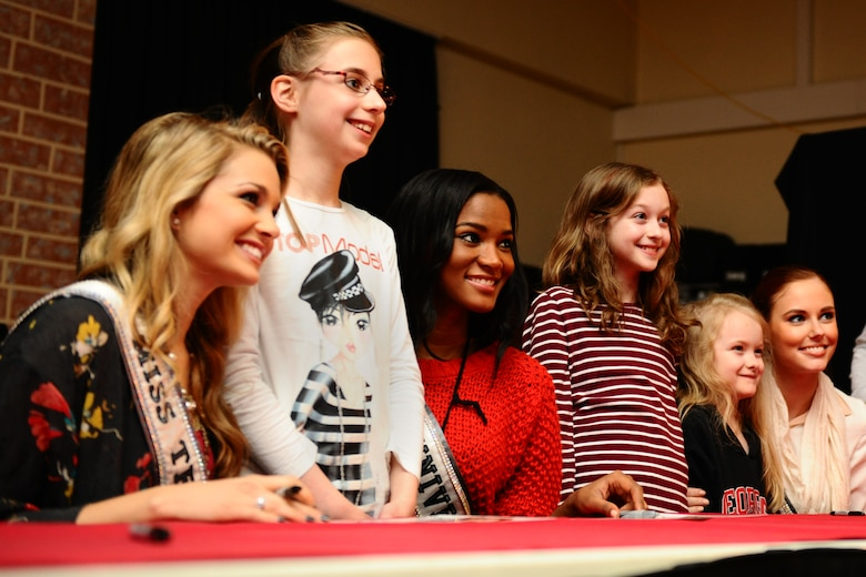 SPANGDAHLEM AIR BASE, Germany – Danielle Doty, Miss Teen USA 2011; Maren Thiel; Leila Lopez, Miss Universe 2011; Hannah Rice; Megan Rice; and Alyssa Campanella, Miss USA 2011, pose for a picture at the Brick House during their USO and Armed Forces Entertainment tour here March 13. The purpose of the tour was to boost morale and show support to U.S. service members and their families stationed in Germany. (U.S. Air Force photo by Airman 1st Class Matthew B. Fredericks/Released)