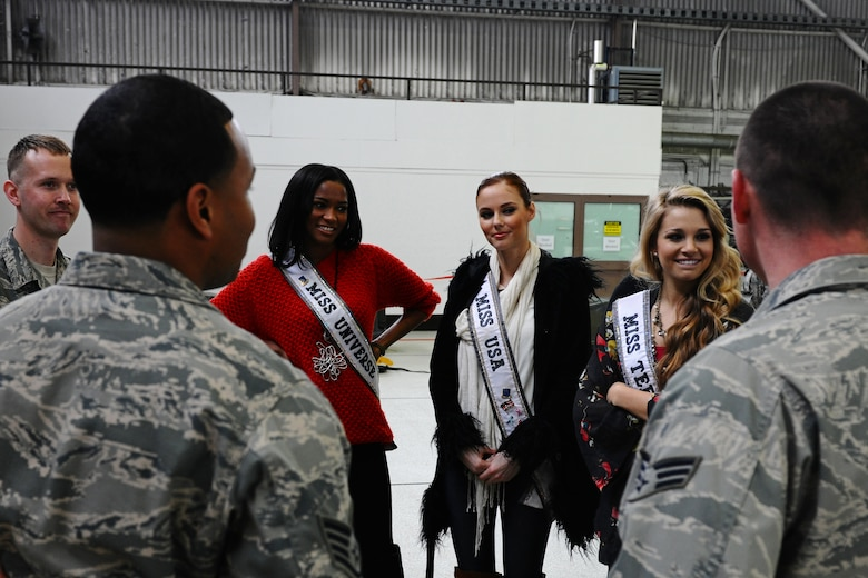 SPANGDAHLEM AIR BASE, Germany – Leila Lopez, Miss Universe 2011, left; Alyssa Campanella, Miss USA 2011, middle; and Danielle Doty, Miss Teen USA 2011, talk with Airman from the 52nd Fighter Wing during their USO and Armed Forces Entertainment tour in Hanger 1 here March 13. The purpose of the tour was to boost morale and show support to U.S. service members and their families stationed in Germany. (U.S. Air Force photo by Airman 1st Class Matthew B. Fredericks/Released)