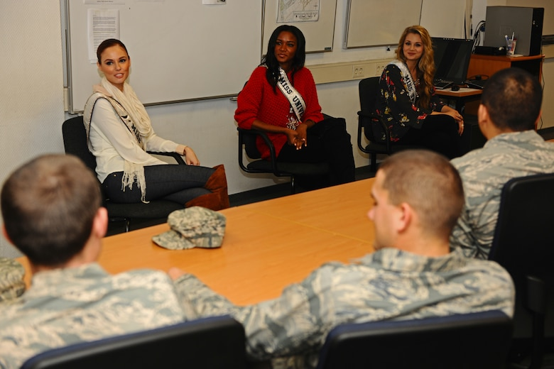 SPANGDAHLEM AIR BASE, Germany – Alyssa Campanella, Miss USA 2011, left; Leila Lopez, Miss Universe 2011, middle; and Danielle Doty, Miss Teen USA 2011, talk with Airman at the First Term Airmen's Center classroom during their USO and Armed Forces Entertainment tour here March 13. The purpose of the tour was to boost morale and show support to U.S. service members and their families stationed in Germany. (U.S. Air Force photo by Airman 1st Class Matthew B. Fredericks/Released)