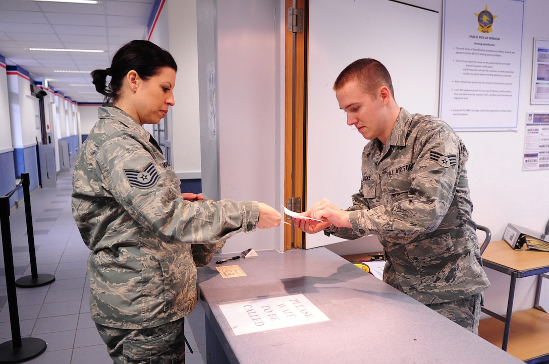 Senior Airman Devin Lucas, 86th Communications Squadron, assist a customer at the parcel pick-up window, Northside Post Office, Ramstein Air Base, Germany, March 12, 2012. Daily tasks for Postal Airmen include unloading delivery trucks, marking parcels, receiving and pitching mail packages, all while continuing to provide quality customer service for the entire Kaiserslautern Military Community. (U.S. Air Force photo by Senior Airman Brittany Perry)
