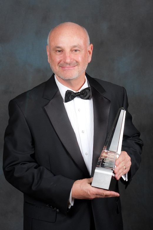 Dave Madden, director of the Military Satellite Communications Systems Directorate,  poses with the 2012 Aviation Week Laureate Award, during the 55th Annual Laureate Awards ceremony, held March 7, in Washington D.C.