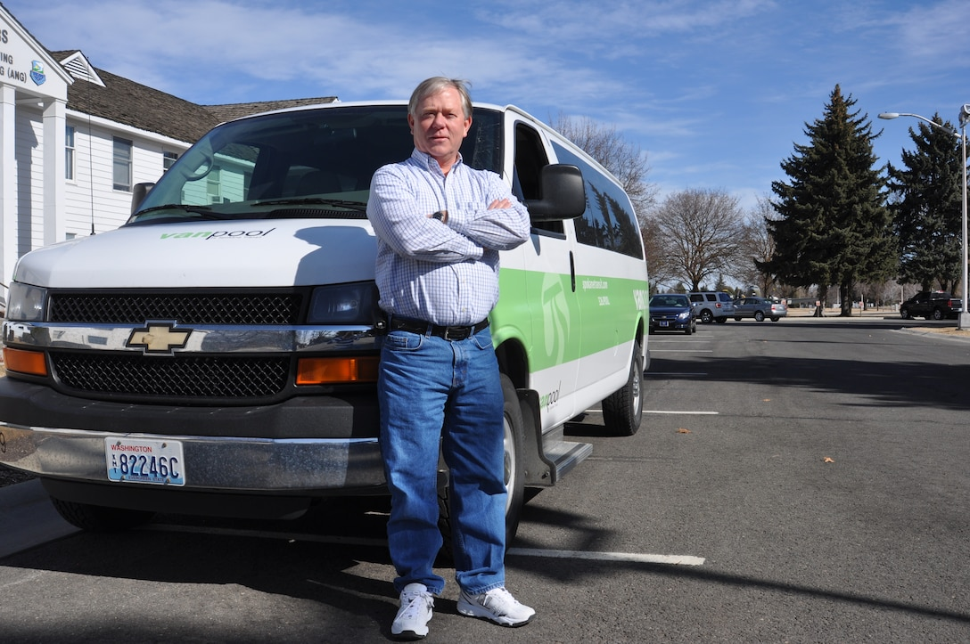 Gerald Johnson, 92nd Civil Engineer Squadron, stands with his Spokane Transit Van in front of the base headquarters March 9. Over the past 11 years, his vanpool has saved more than 1 million miles on personal vehicles. (U.S. Air Force photo by Scott King)