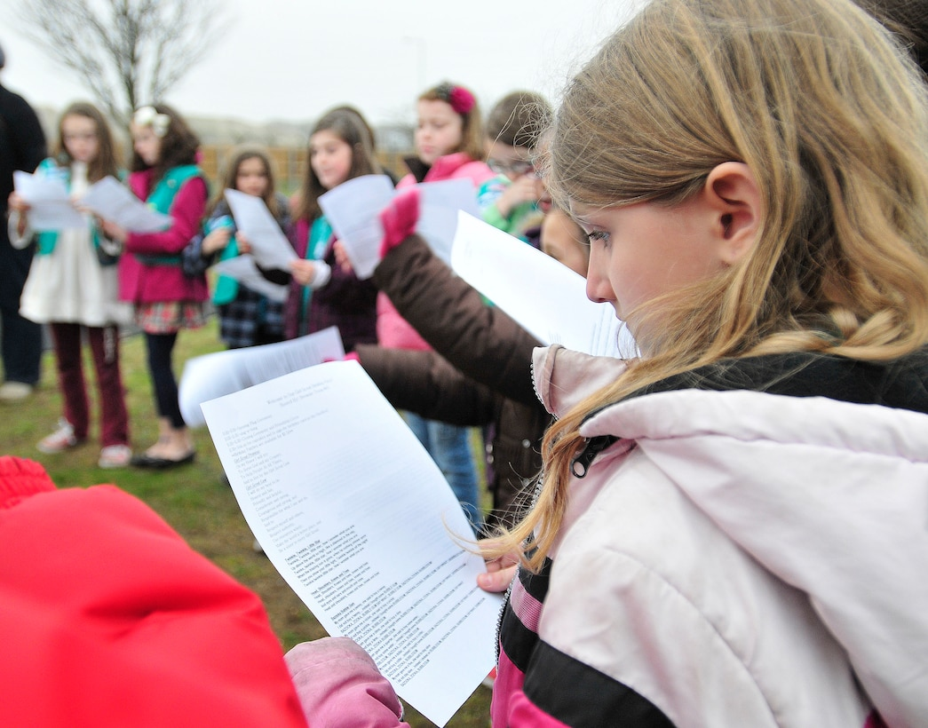ROYAL AIR FORCE LAKENHEATH, England - Rebekah Cox, Junior Girl Scout Troop 01, sings along with other girls during the Girl Scouts' 100th Birthday event at Defender's Park March 12, 2012. The event, planned by the members of Anglia Brownie Troop 43, included a group sing-along, friendship circle, cupcakes and fun. (U.S. Air Force photo by Senior Airman Tiffany M. Deuel)