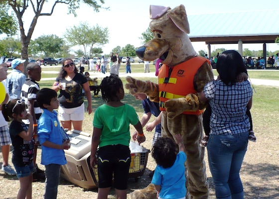 "TEXAS — Bill Krampe of the U.S. Army Corps of Engineers Galveston District doubles as ""Bobber"" the Water Safety Dog to educate children about water safety. Krampe has been employed by the USACE Galveston District for 23 years and is the district's spotlight for March 2012."