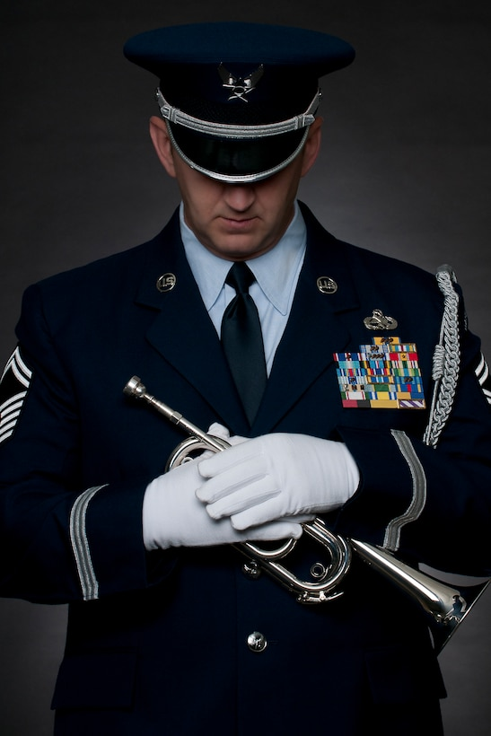 Senior Master Sgt Todd Kirkwood, 167th Airlift Wing avionics supervisor and base honor guard member, recently stepped up to play Taps at a funeral when the electronic device in the Ceremonial Bugle being used by the civilian color guard team failed to sound. Kirkwood and one other member of the unit's honor guard were tasked to fold the flag and present it to the family, but when the bugle failed Kirkwood was able to remove the electronic device from the instrument and sound Taps, which he only recently learned to play. (U.S. Air Force photo by Master Sgt. Emily Bieghtol-Deyerle)