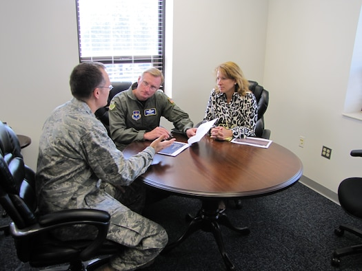 Kathleen Fadok, right, accompanies Maj. Gen. David Fadok, center, commander and president of the Air University, as he receives a briefing from Maj. John Redfield, director of Air University Public Affairs in this August 2011 photo. (Air Force photo/Jessica Casserly)