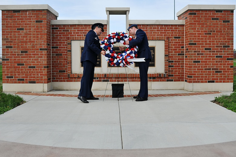 Col. Pete Nezamis (left), Commander, 126th Air Refueling Wing, and Lt. Col. Leslie Summers, a chaplain assigned to the 126th Air Refueling Wing, place a wreath in front of a memorial at Scott AFB, Ill., on March 19, 2012. A ceremony was held to commemorate the four 126th Air Refueling Wing aircrew members who perished in an aircraft accident 30 years ago. Maj. William S. Dixon, Jr., Capt. Kenneth L. Herrick, Capt. Robert J. Nicosia and Master Sgt. Richard A. Crome were aboard a Illinois National Guard KC-135A Stratotanker while on a routine training mission when their plane exploded near Greenwood, Ill. In addition, 23 members of the 928th Tactical Airlift Group, Air Force Reserves, who were passengers also lost their lives. (National Guard photo by Master Sgt. Ken Stephens)
