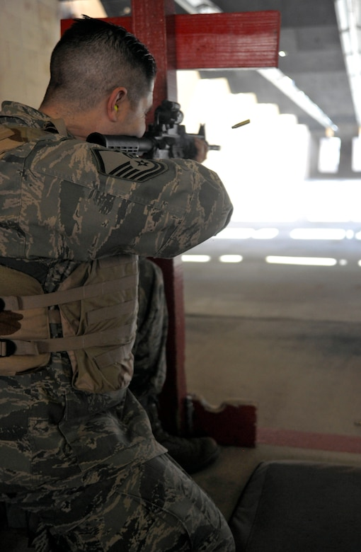 Master Sgt. Anthony Baeza, 70th Intelligence Surveillance and Reconnaissance Wing NCO in charge, takes aim at down-range targets at the Combat Arms Training and Maintenance (CATM) facility Feb. 14. (U.S. Air Force photo/Airman 1st Class Lindsey A. Beadle)