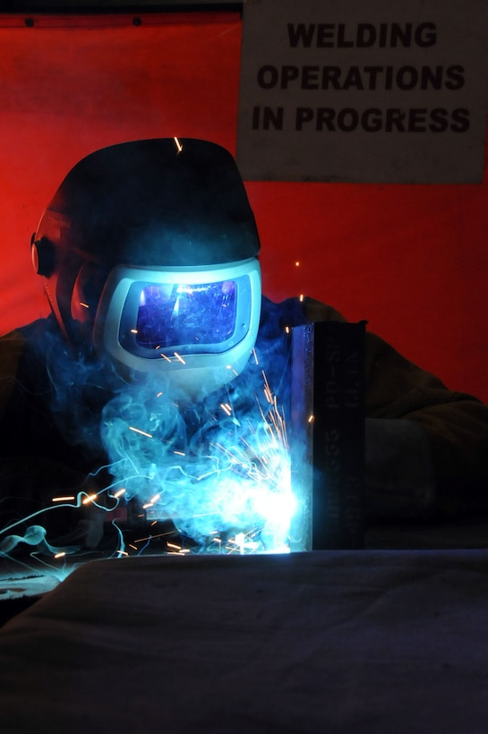U.S. Air Force Staff Sgt. Matthew Johnson, 386th Expeditionary Maintenance Squadron metals technician, demonstrates welding capabilities on a piece of steel at an undisclosed location in Southwest Asia, March 16, 2012.  Johnson is native to Mishawaka, Ind., and is deployed from the 122nd Maintenance Squadron in Ft. Wayne, Ind. (U.S. Air Force Staff Sgt. James Lieth)