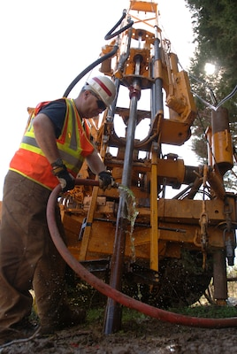 Drill Rig Operator John Blackson, U.S. Army Corps of Engineers Baltimore District, conducts drilling operations near the Nashville District's Saddle Dam at Center Hill Lake March 14, 2012.