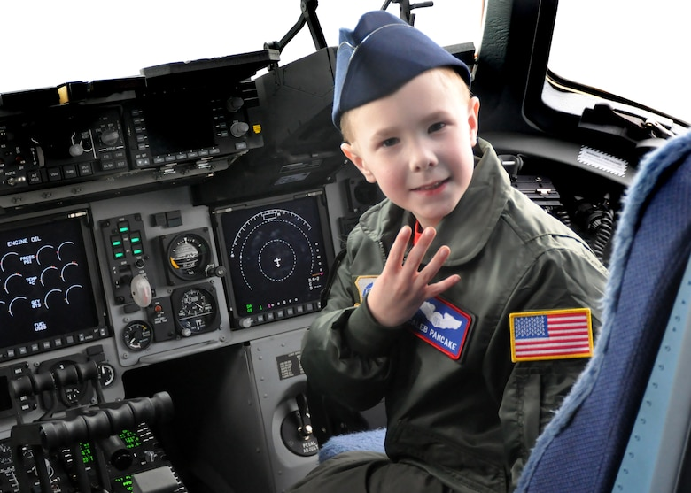Caleb Pancake sits in the cockpit of a C-17 Globemaster III as part of the Pilot for a Day program March 16, 2012, at Joint Base Lewis-McChord, Wash. Pilot for a Day is an Air Force program that enables challenged youth a chance to visit a military installation, becoming part of the team in the process. (U.S. Air Force photo/Airman 1st Class Leah Young)