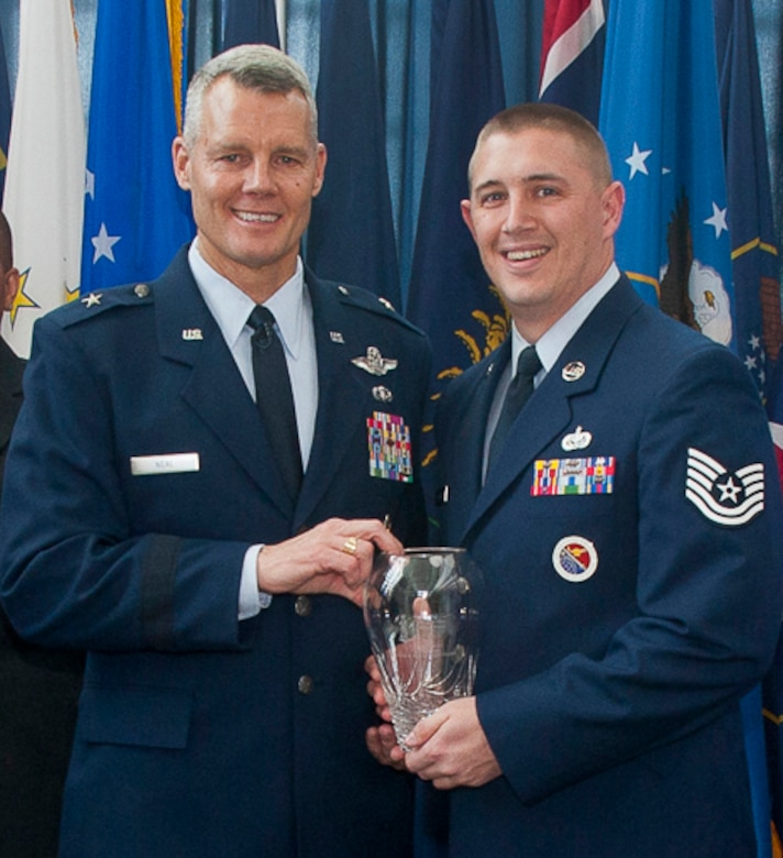 JOINT BASE ANDREWS, Md. - Tech. Sgt. Derek J. Westfall, right, an enlisted professional military education instructor at the I.G. Brown Training and Education Center, McGhee Tyson Air National Guard Base, Tenn., receives the 2011 Air National Guard Readiness Center NCO of the Year award from Brig. Gen. Brian G. Neal, ANGRC commander, during a ceremony held at Joint Base Andrews, Md., March 1, 2012. (Air National Guard photo by Master Sgt. Marvin Preston/Released)