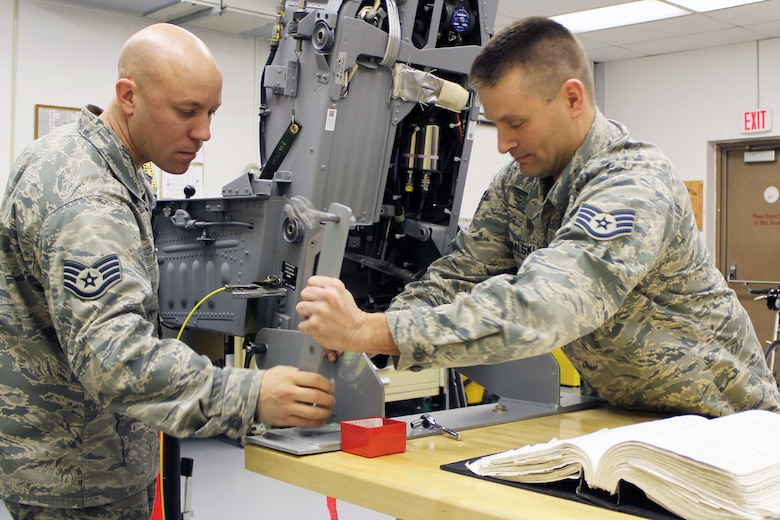 Staff Sgt. Jared Kowalski (right) and Staff Sgt. Nathan Henkel perform routine, scheduled maintenance on the ACES-II ejection seat system in their role as egress technicians for the 127th Maintenance Squadron at Selfridge Air National Guard Base, Mich. The seat is used on the A-10 Thunderbolt II aircraft, which may be eliminated from Selfridge under a pending Air Force budget proposal. (U.S. Air Force photo by TSgt. Dan Heaton)