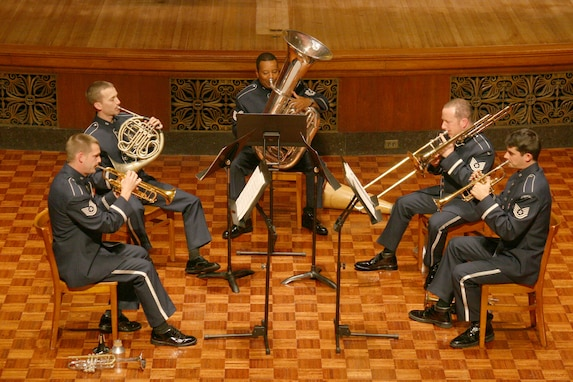 A brass quintet consisting of U.S. Air Force Band members performs.  On Apr. 13 at The Lyceum in Alexandria, Va., there will be an Evening of Music for Brass Quintet featuring a mix of classic and contemporary music.