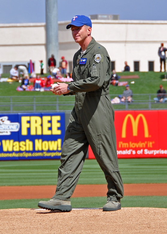 """Brig. Gen. William B. Binger, commander, 10th Air Force, threw out the first pitch during a Spring Training game Monday at Surprise Stadium in Ariz. The commander, visiting from Headquarters in Ft. Worth, Texas, donned a Rangers cap for the special event hosted by the City of Surprise.   """"It is an honor to have our Air Force partners here with us,"""" said Surprise Mayor Sharon Wolcott. """"We are so proud of our military members stationed right here at Luke Air Force Base, it is wonderful to be able to just get out and share the great American past-time of baseball with our men and women in uniform.""""   """"This was wonderful!"""" said General Binger, who admits he is fond of the West Valley and enjoys getting back to Arizona for flight currency training.   """"I got to fly this morning and enjoy this game this afternoon, this is a good day,"""" he said. """"I owe a huge thanks to the City of Surprise for their kindness and hospitality. The 944th Fight Wing is lucky to have such outstanding community support."""""""