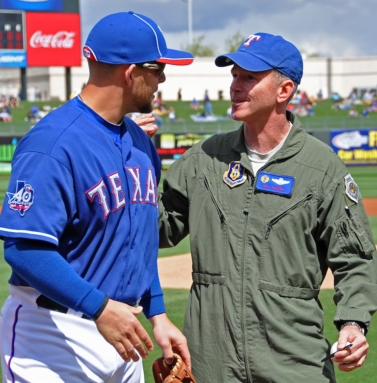 Texas Rangers' Brandon Snyder represented his team March 19, when he caught for 10th Air Force Commander, Brig. Gen. William B. Binger's first pitch at the Spring Training game at Surprise Stadium in Ariz. (U.S. Air Force Photo by Staff Sgt. Denise Willhite)