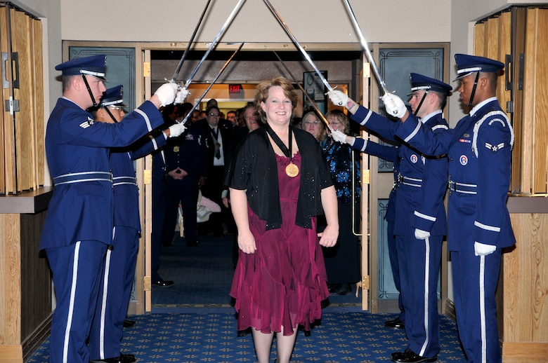 AFOTEC Civilian Category II nominee/winner Gail Broxson enters the awards banquet ballroom through the honorary saber arch.