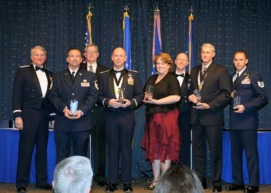(Left to right) Maj. Gen. David J. Eichhorn, Air Force Operational Test and Evaluation Center Commander, joins some of the 2011 AFOTEC Annual Award Winners and distinguished guests that include Master Sgt. Michael Kuhn; Guest Speaker Dr. J. Michael Gilmore; Capt. Donald Tinsley; Gail Broxson; AFOTEC Chief Enlisted Manager Chief Master Sgt. Daniel Whitcomb; Jeffrey Wilson; and Tech Sgt. Jeffery Womack.
