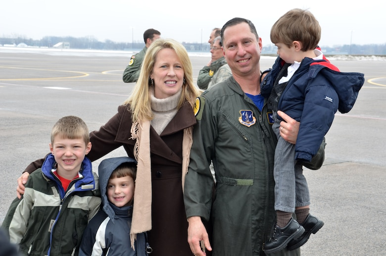 """Col. Pete """"Meat"""" Siana is surrounded by his family after completing his """"fini-flight"""" March 3, 2012, at Bradley Air National Guard Base, East Granby, Conn. With Siana are his wife Dawn and three boys Peter, 7, Joseph, 6 and Jack, who is 2. (U.S. Air Force photo by Tech. Sgt. Joshua Mead)"""