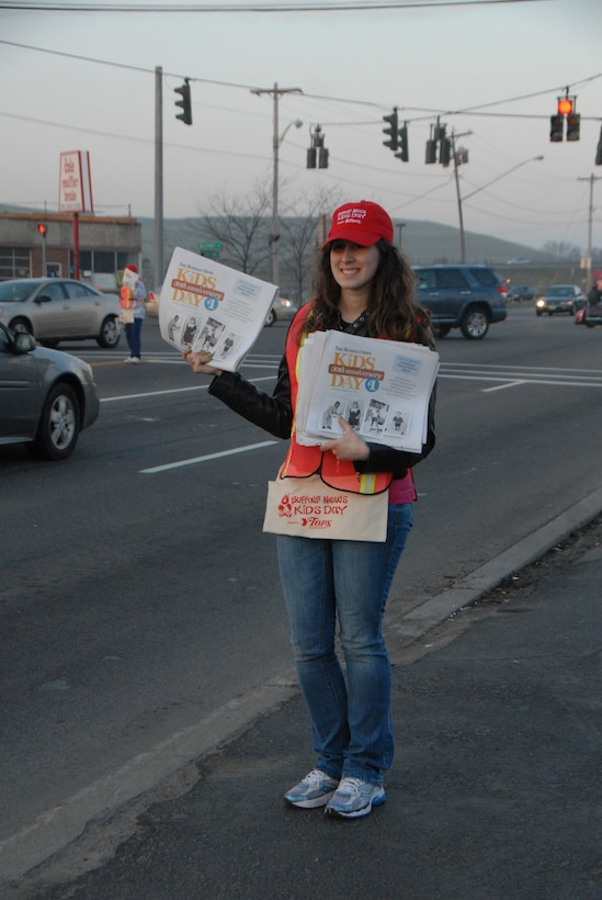 Staff Sgt. Sharon Gouchie of the 107th Airlift Wing, Niagara Falls NY volunteered to sell Buffalo News Kids Day papers. The proceeds benefit Women & Children's Hospital.(Air Force Photo/ Tech Sgt. Catherine Perretta)