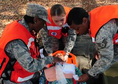 628th Medical Group personnel perform simulated life saving techniques on a volunteer  at Joint Base Charleston - Air Base March 20. During the active shooter scenario, the Anti-Terrorism/Force Protection exercise evaluated JB Charleston's capabilities in responding to a crisis situation. (U.S. Air Force photo/Staff Sgt. Katie Gieratz)