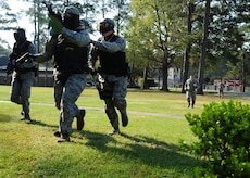 628th Security Forces Squadron members respond to a simulated terrorist attack at Joint Base Charleston - Air Base March 20. During the active shooter scenario, the Anti-Terrorism/Force Protection exercise evaluated JB Charleston's capabilities in responding to a crisis situation. (U.S. Air Force photo/Staff Sgt. Katie Gieratz)
