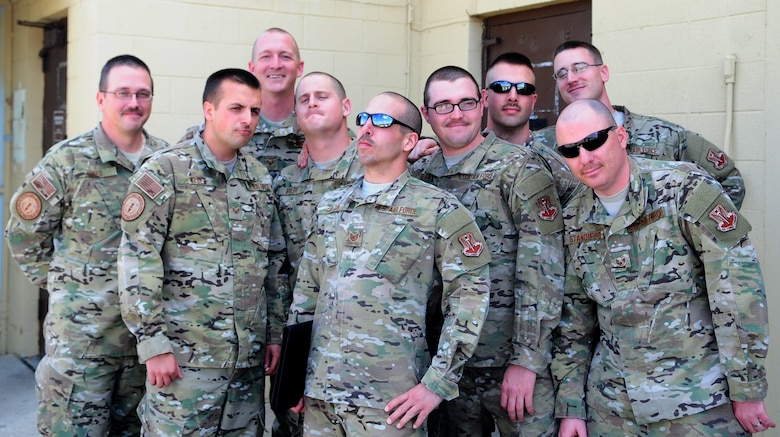 Airmen from the 9th Munitions Squadron, Beale AFB, Calif., proudly display the progress of their mustaches. The entire squadron was challenged to a competition by their commander in observance of Mustache March, which is famed across the Department of Defense. (U.S. Air Force photo by Senior Airman Shawn Nickel/Released)