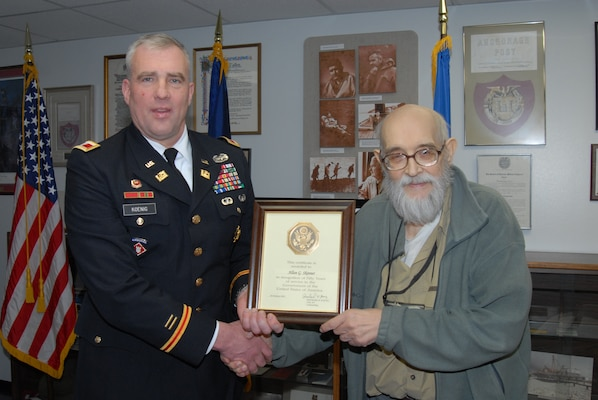 ALASKA — Allan Skinner, U.S. Army Corps of Engineers Alaska District regulatory specialist, accepts a certificate in recognition of 50 years of federal service from Col. Reinhard Koenig, Alaska District commander, during a ceremony at the district headquarters building Feb. 2, 2012.