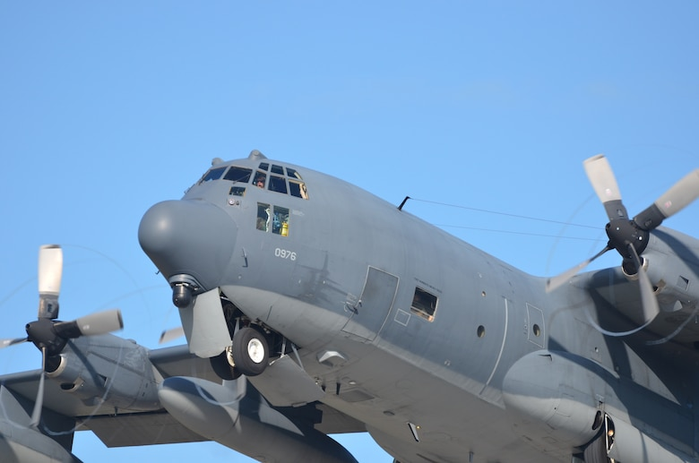 U.S. Airmen from the 39th Rescue Squadron, Patrick Air Force Base, Fla., pilot an HC-130P/N King aircraft in search and rescue competition over Marathon Key, Fla., against Royal Canadian Airmen from the 435 Squadron, Manitoba, Canada. Both squadrons perform search and rescue and compete several times annually to enhance their rescue capabilities. (U.S. Air Force photo/Capt. Cathleen Snow)