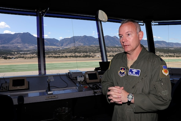 Lt. Col Brad Roller explains the benefits of the new sailplane landing area from the control tower at the Air Force Academy March 20, 2012. Roller commands the 94th Flying Training Squadron, an Air Education and Training Command tenant unit here. (U.S. Air Force photo/Mike Kaplan)