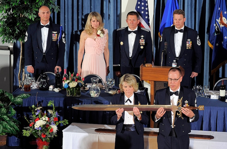 Chief Master Sgts. Carolyn Henriques of the 10th Force Support Squadron and Randall Doersch of the Air Force Academy Band, perform their duties as Keepers of the Sword during an Order of the Sword ceremony for Academy Superintendent Lt. Gen. Mike Gould March 19, 2012. Gould is the 234th inductee into the Order of the Sword. (U.S. Air Force photo/Raymond McCoy)