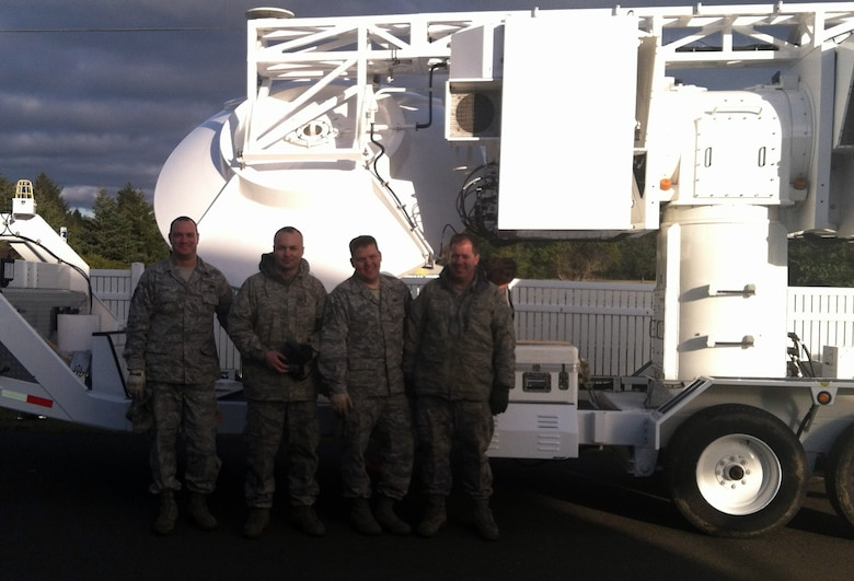 Members of the 266th Range Squadron pose in front of the Joint Threat Emitter Unit Feb. 16, 2012, at Pacific Beach, Wash. The 266th RANS personnel stationed at Mountain Home Air Force Base, Idaho, operate surface-to-air missile simulators helping test aircrew's ability to recognize a threat then identify and react correctly according to the specific situation presented. (Courtesy photo)