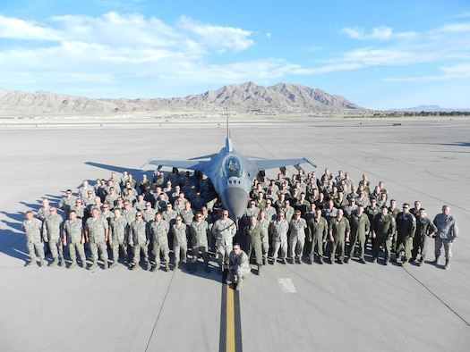More than 150 148th Fighter Wing members pose with a Block 50 F-16 Mar. 15, 2012 at Nellis Air Force Base, Nevada.  The 148th participated in Red Flag, a final exercise at the tail end of the 148th's conversion to the Block 50 F-16 from Feb. 27 to Mar. 16. (Courtesy photo.)