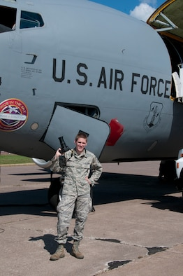 "Tech. Sgt. Scott G. Herrington poses in front of a KC-135 after  an orientation flight at the 148th Fighter Wing. Herrington, a journalist at the 148th, has been named the Air National Guard's ""Outstanding New Writer of the Year"" for 2011. (National Guard photo by Master Sgt. Ralph j. Kapustka.)"