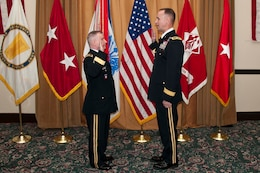 "SAN FRANCISCO — Maj. Gen. Merdith ""Bo"" Temple, acting Chief of Engineers for the U.S. Army Corps of Engineers, administers the officer's oath to newly promoted Brig. Gen. Mike Wehr, USACE South Pacific Division Commander, at a Frocking Ceremony, March 15, 2012."