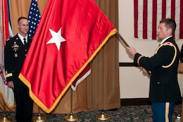SAN FRANCISCO — Capt. Chris Herold unfurls the one-star-flag of Brig. Gen. Mike Wehr at a Frocking Ceremony March 15, 2012. Wehr is the U.S. Army Corps of Engineers South Pacific Division Commander