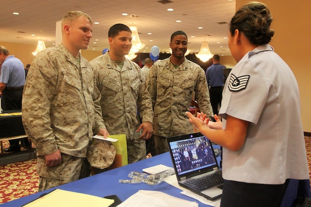 Marines listen intently to an Air Force Reserve recruiter during the annual Spring Career and Education Expo at Camp Pendleton's Pacific Views Event Center, March 22. The expo offered Marines and their family members information about different career opportunities available to them to assist them with an easy transition out of the Corps.