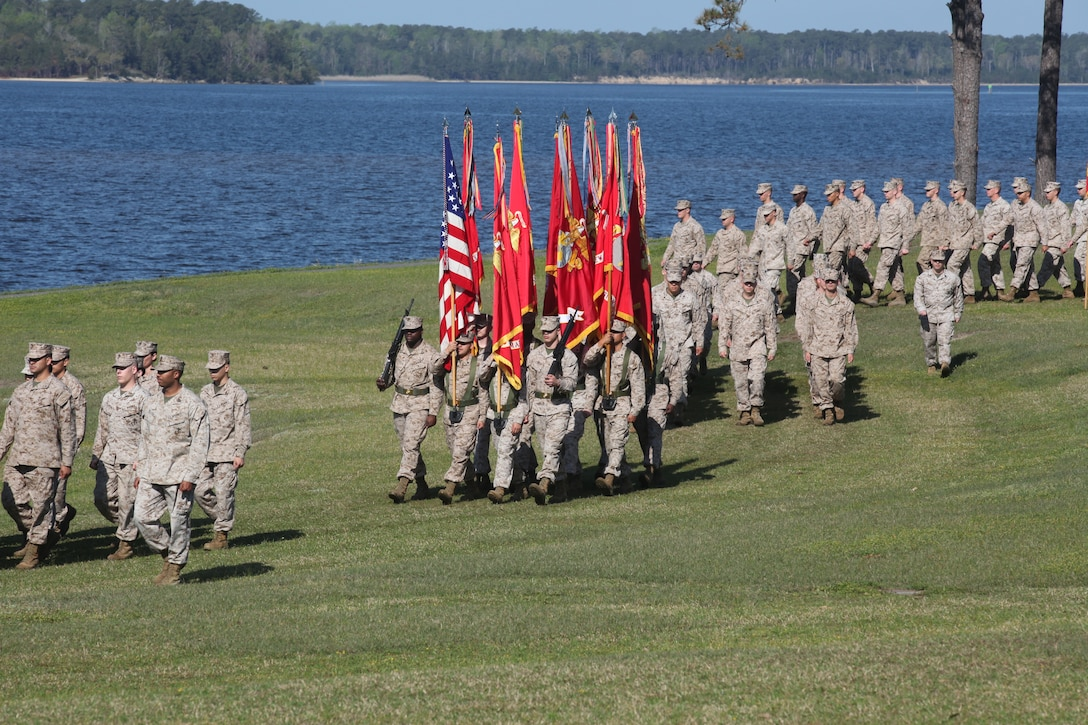 Marines march out to begin the relief and appointment ceremony held aboard Marine Corps Base Camp Lejeune. Sgt. Maj. Robert G. VanOostrom, who served as sergeant major for Marine Corps Installations East from August 2009 to March 2012, handed over the Sword of Office to Sgt. Maj. Ernest K. Hoopii, the new sergeant major for MCIEAST.
